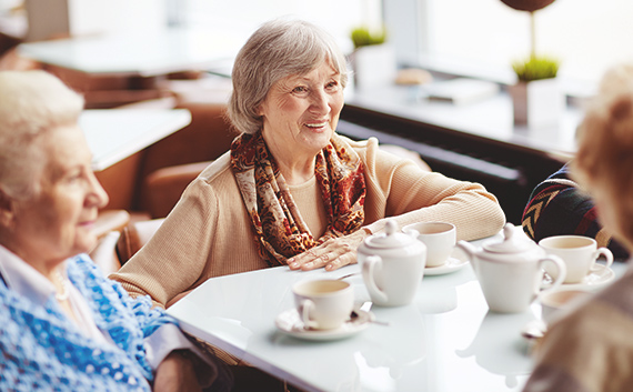 Women sitting at a table having coffee